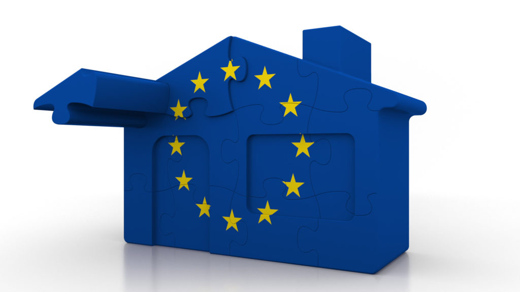 Building puzzle house featuring flag of the European Union. EU e